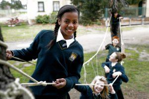 Students climbing ropes