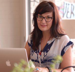 Jocelyn Brewer sitting at computer
