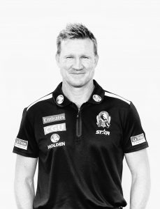 Black and white photo of Nathan Buckley standing