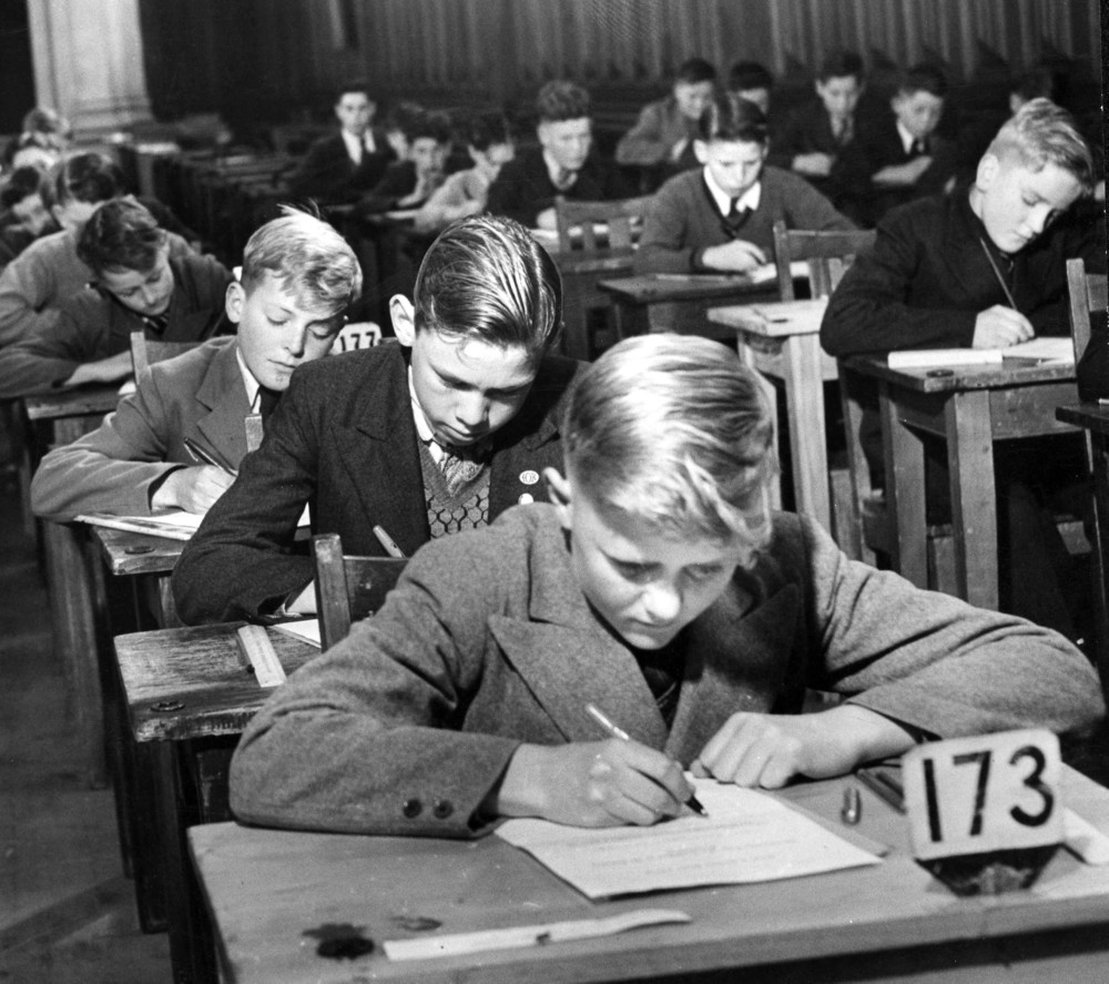 Black and white photo of boys sitting exams