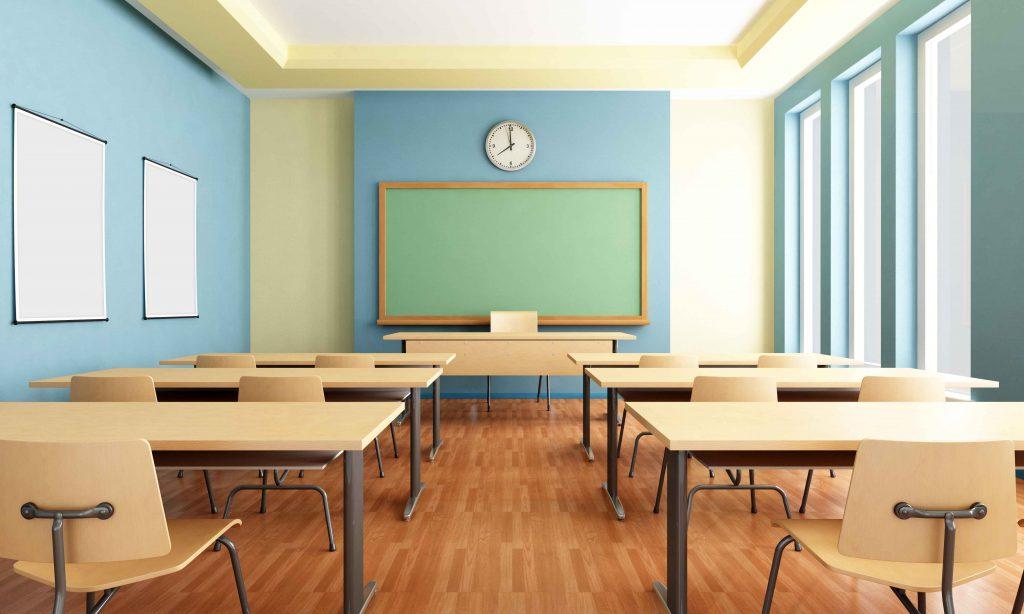 Empty classroom with desks and blackboard.
