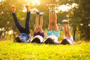 Kids lying on grass exercising