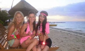Three young women on a beach in Fiji on Schoolies