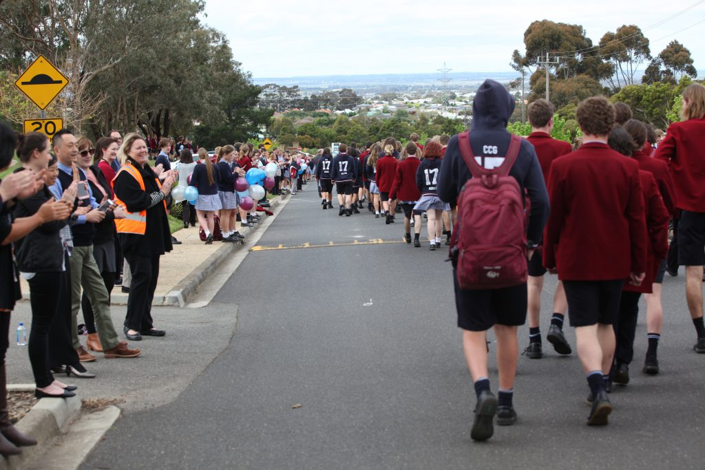 Year 12 students parade at Christian College Geeloing applauded by teachers and students