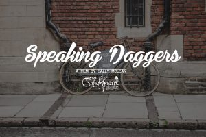 Bicycle leaning up against wall with title Speaking Daggers