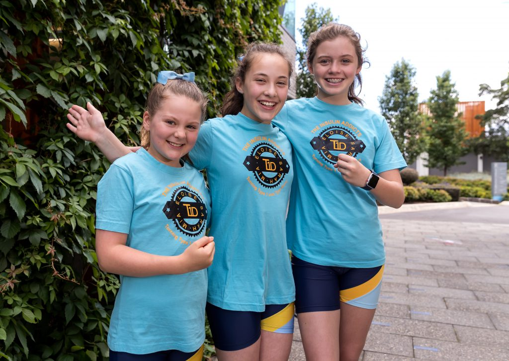Three girls in blue t-shirts