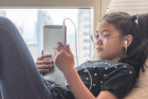 Girl Watching on her iPad