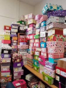 Colourful Shoeboxes4Syria stacked up at Al Siraat College