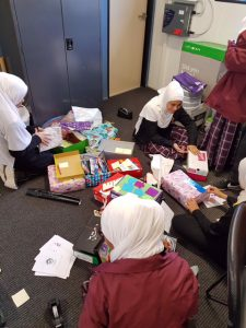 Al Siraat students packing Shoeboxes4Syria