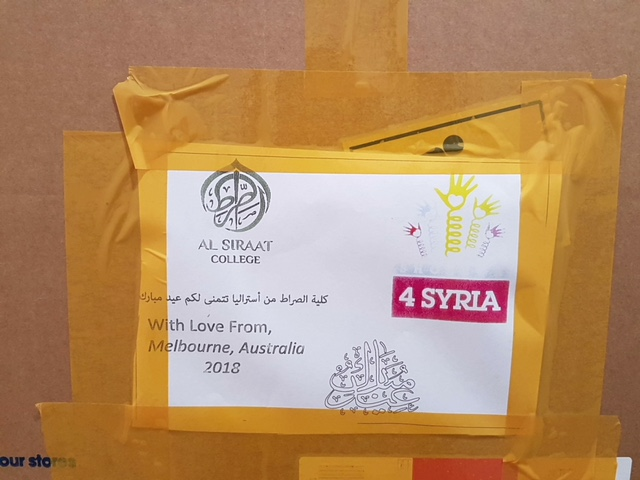 White postal label for the Shoeboxes4Syria project.