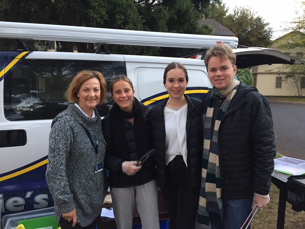 Teacher and students from St Leonard's College in front of Lennie's Van.