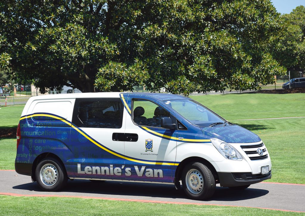 Blue, white and gold van with Lennie's Van written on the side