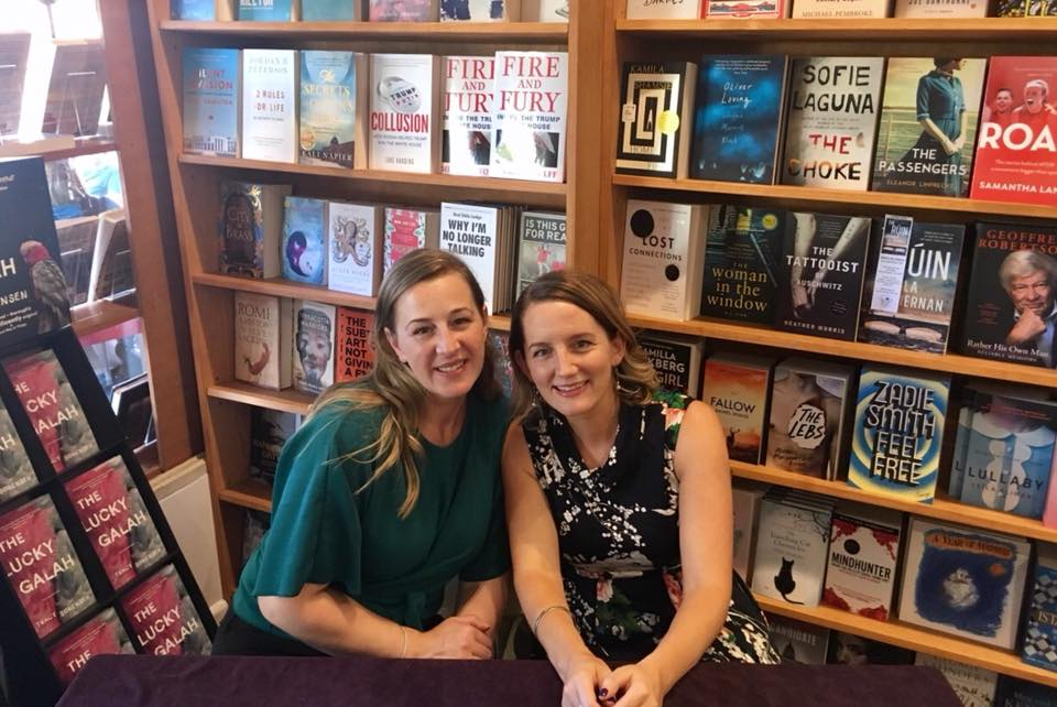 Danielle Ross Walls and Louise Correcha at the launch of Working Mums, sitting together in front of a book case