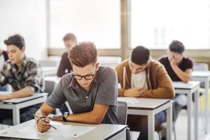 How to Deal with Exam Stress and Anxiety | Image of students sitting exams