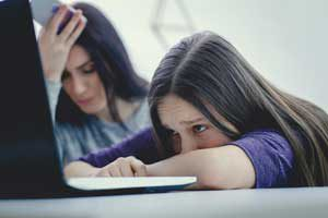 Image of girl and parent dealing with cybersafety | The Parents' Website
