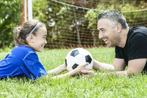 Image of father and daughter bonding over sport | The Parents' Website