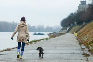 The Parents' Website | Girl walking a dog in cold weather