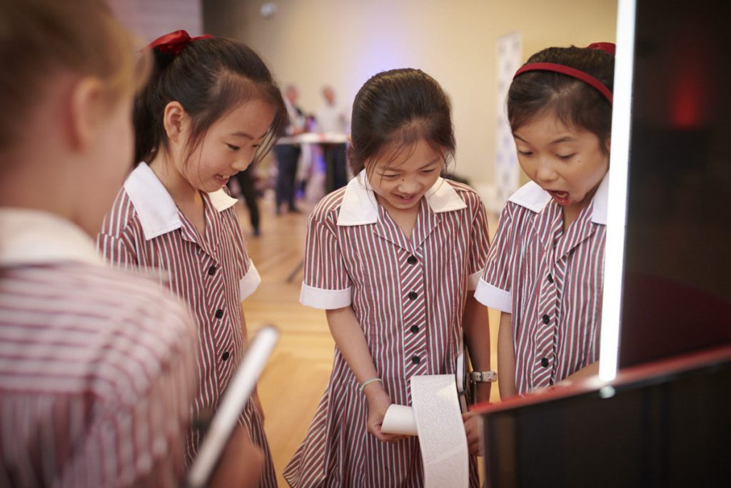 Students from Korowa Anglican Girls' Grammar try out the short story dispensers