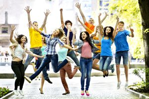 The Parents' Website | Older students jumping for joy
