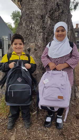 Al Siraat students with starter school bags bound for Pakistan.