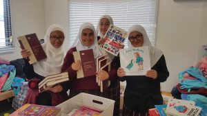 Community Connections - Students at Al Siraat College packing books for poor children in Pakistan