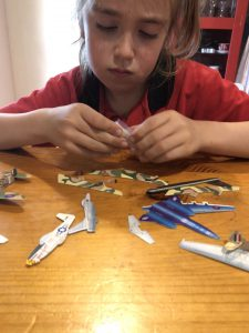 The Parents' Website | Image of a boy making planes