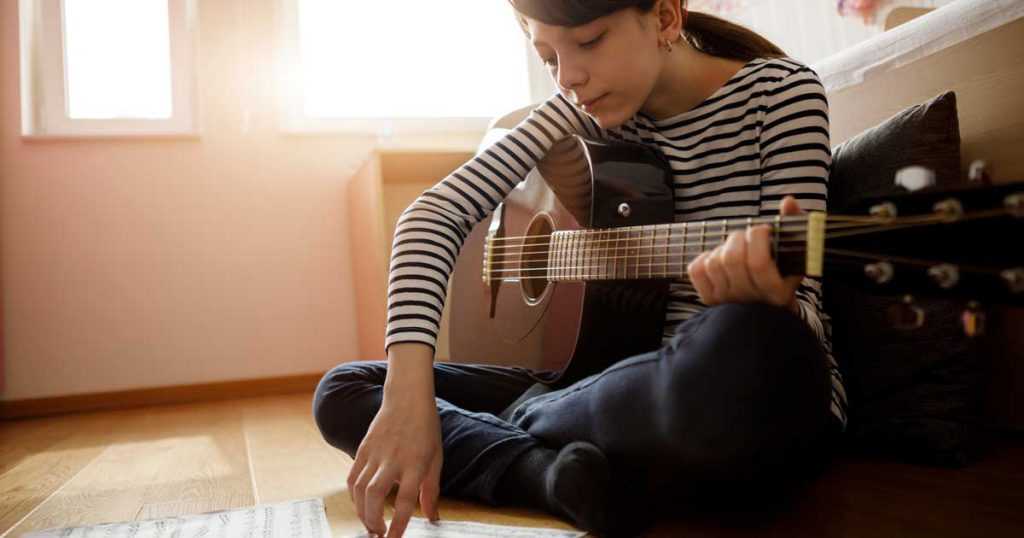 The Parents' Website | Image of girl playing guitar