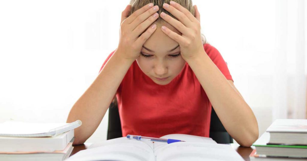 The Parents' Website | Image of girl struggling with homework