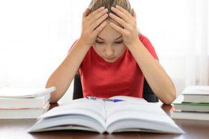 The Parents' Website | Image of girl struggling with homework