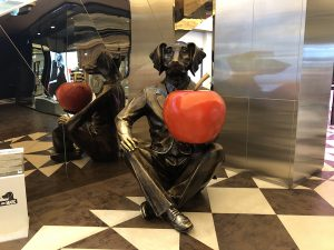 The Dogman - dog in suit holding red apple